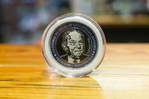 Coin with Walter Snelling's image.